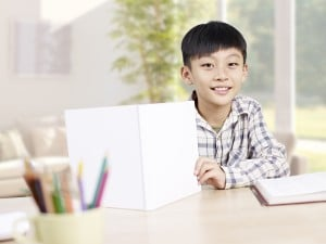 home portrait of a 10 year-old asian elementary schoolboy